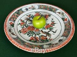 A large Chinese Kangxi Period (1662-1722) Famille-Verte'pie-crust' rim charger